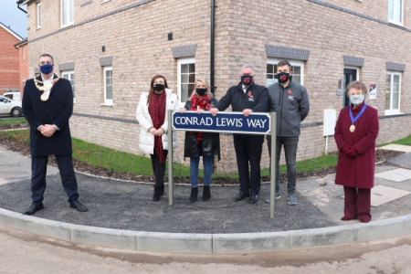 Mayor of Warwick with the family of Conrad Lewis in front of the 'Conrad Lewis Way' sign