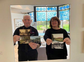 Staff from the Royal Pump Rooms holding the postcards