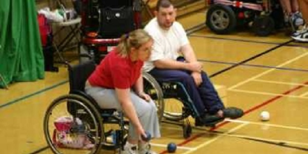 People playing wheelchair bowls