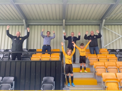 Fans celebrating in the stands at Racing Club Warwick FC